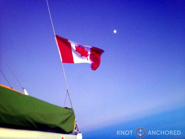 Canadian flag against the moon