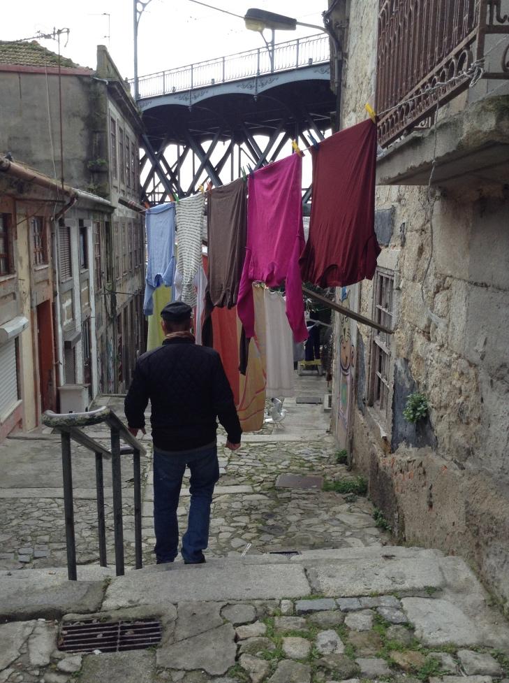 Porto alleyways, hanging laundry, cobblestone