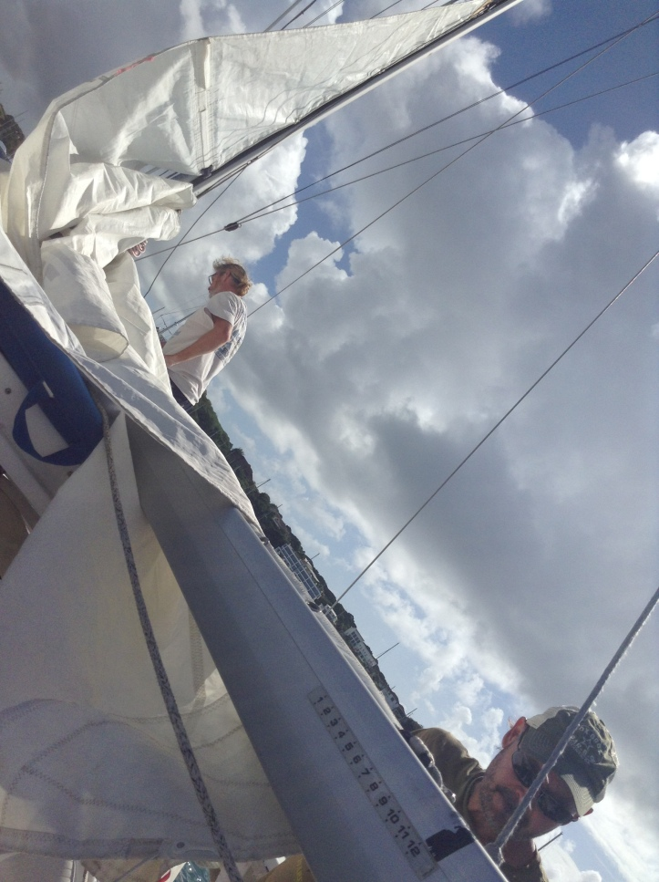 Sails getting put up on Catamaran