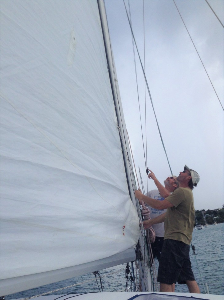 raising the sail, catamaran Forever