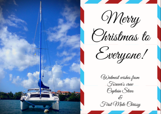 Christmas greetings, catamaran on mooring ball, blue sky, white clouds, Christmas cruising, island cruising, catamaran life, tropical Christmas