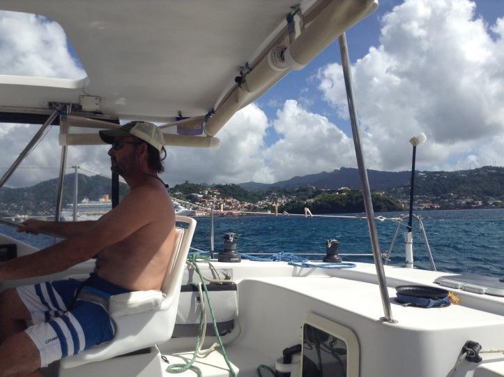 Captain in helm, sailin get, St Georges, Grenada