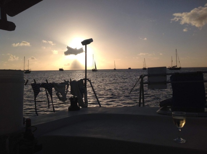 Sunset, sailboats, bikini laundry line, tropical scene