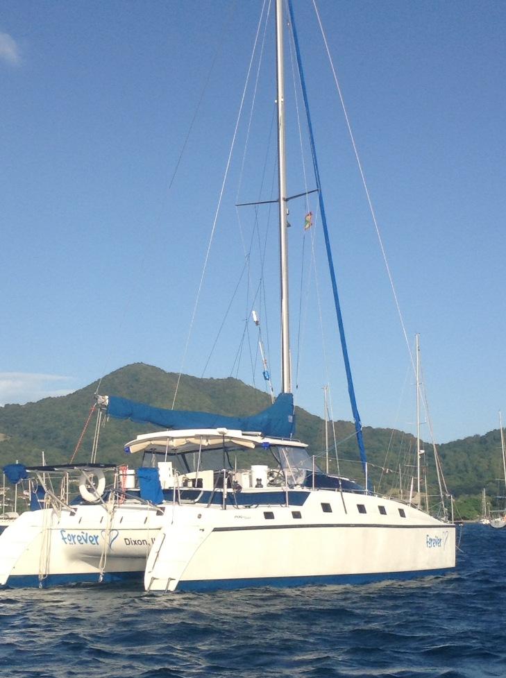 Catamaran on anchor, sailing yacht, for sale