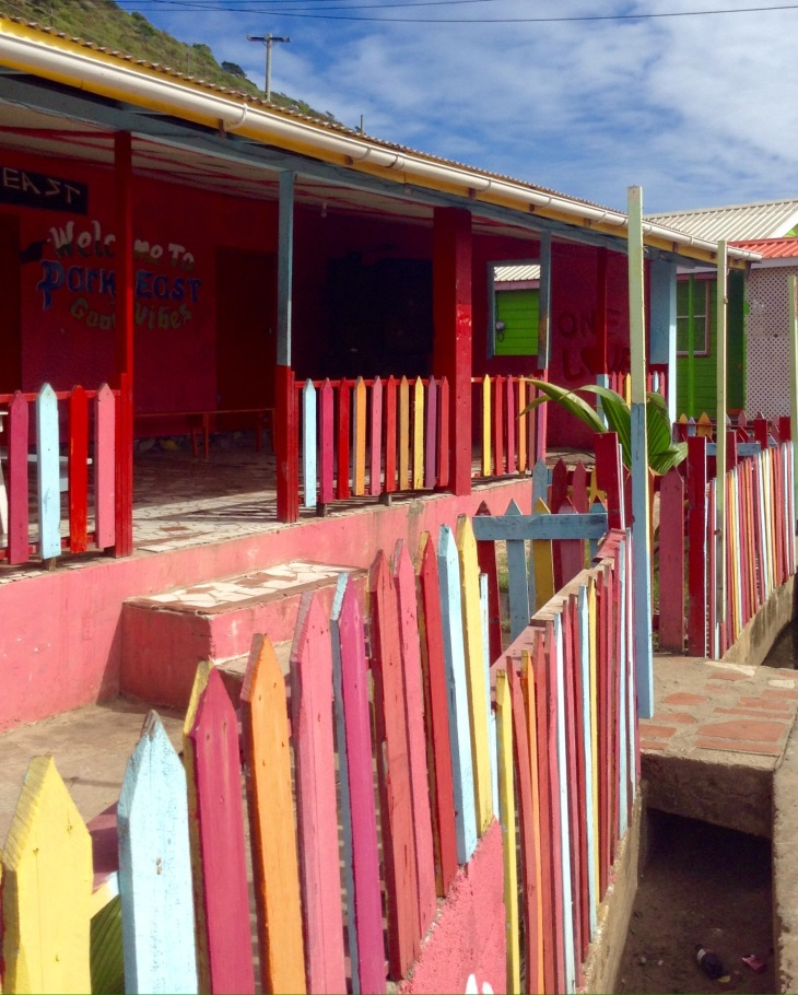 Colorful Caribbean gate, town, Clifton, Union island