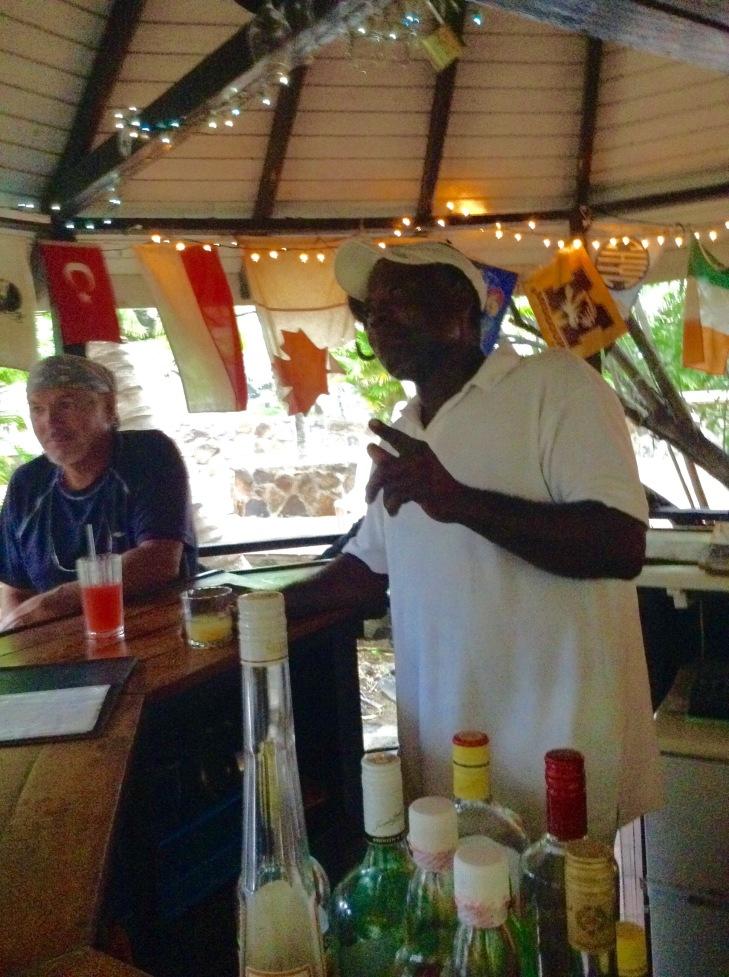 Caribbean bar, bartender, storytelling, Canadian flag, mayreau
