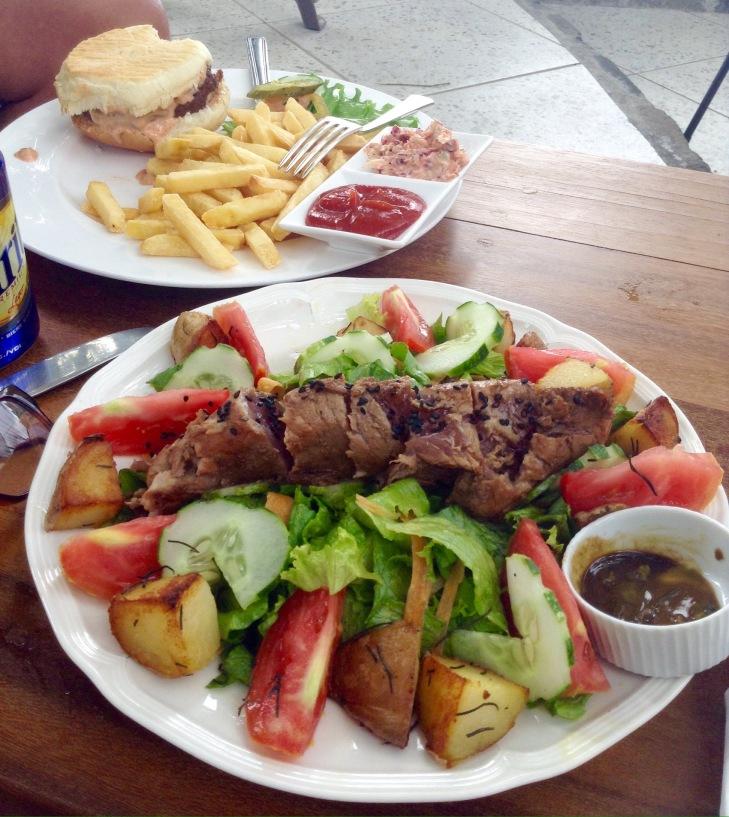 Burger and fries, seared tuna, salad, roast potatoes