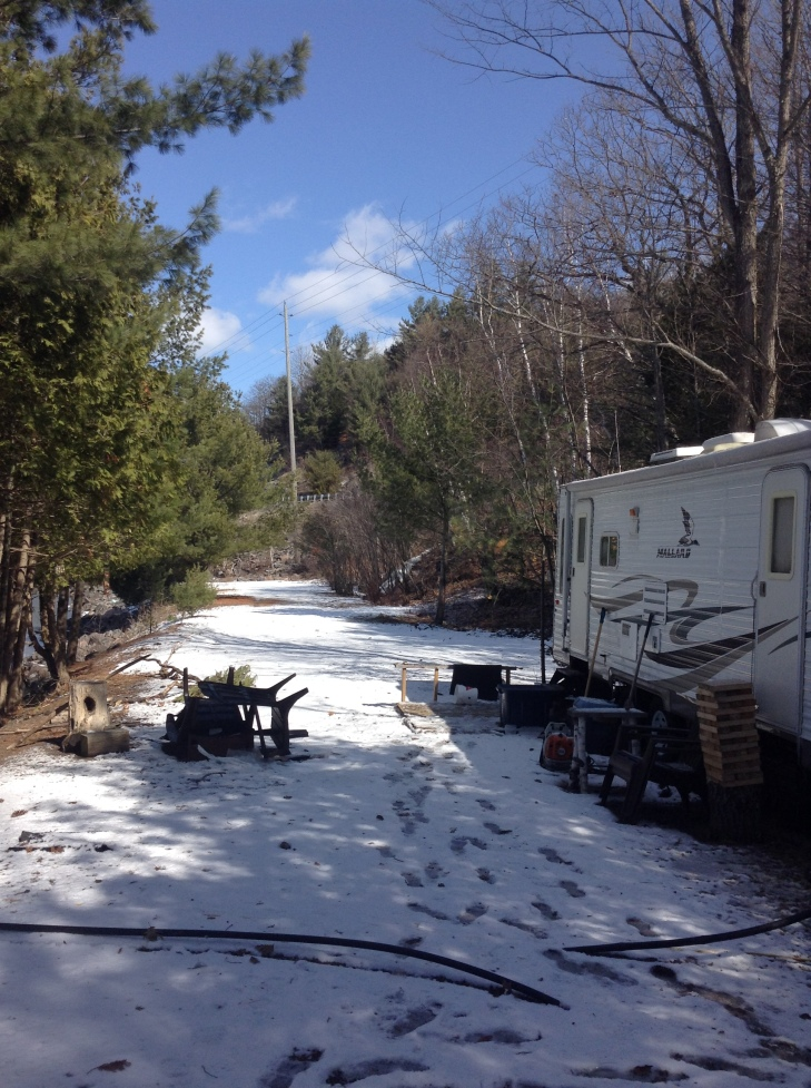 snow covered camp, spring weather, snow storm coming, up north