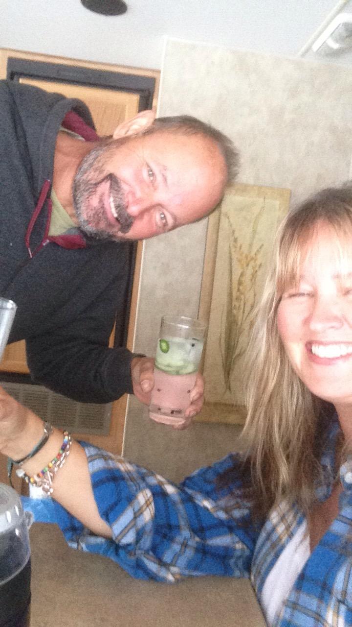 couple, smiling, cheers, plaid shirt