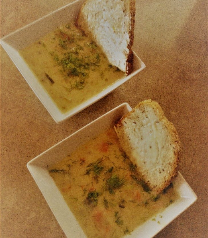 homemade pickle soup served with rye bread and dill